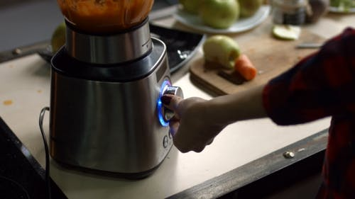 Female Hands Blending Detox Smoothie in Blender