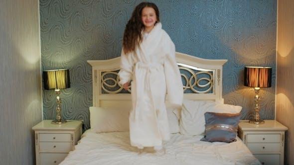 Thumbnail for Child Bedtime Happy Joyful Girl Jumping Bed