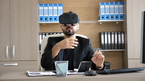 Thumbnail for VR Technology - Young Businessman in the Office Wearing Virtual Reality VR Headset