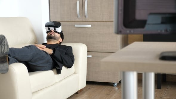 Thumbnail for Businessman Is Taking a Break in His Office Using the VR Headset Technology