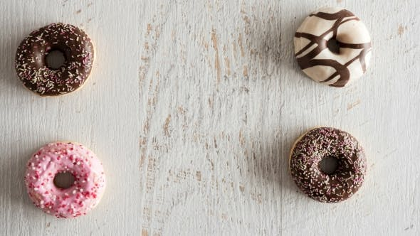Thumbnail for Donuts Moving on White Wooden Background