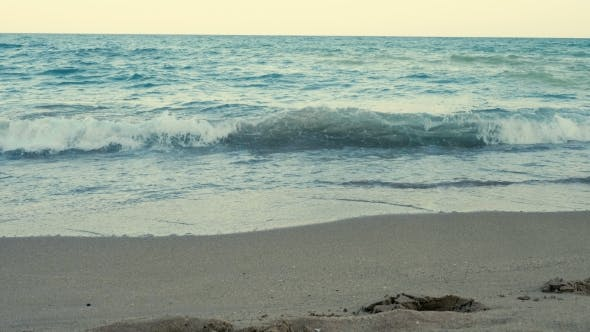 Cover Image for Sea Waves on the Seaside at the Sunset