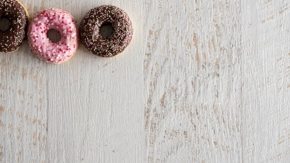 Thumbnail for Stop Motion of Donuts on White Wooden Background