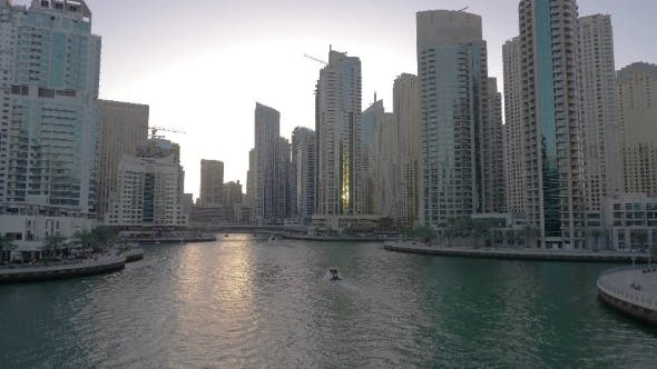 Thumbnail for Ship Floating on Dubai Marina Between Glass Skyscrapers in United Arab Emirates