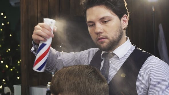 Thumbnail for Professional Barber Spraying Hair of His Client While Styling