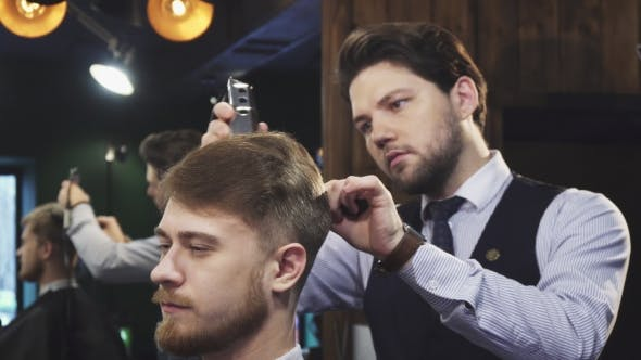 Thumbnail for Professional Barber Working Giving a Haircut To His Client