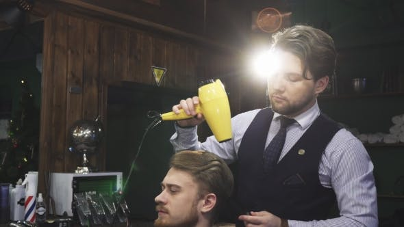 Thumbnail for Handsome Bearded Professional Barber Working with His Client