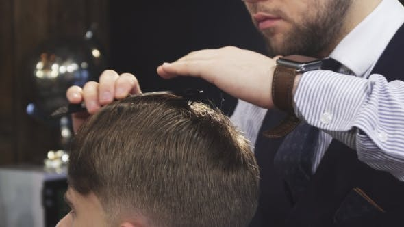 Thumbnail for of a Professional Barber Spraying Hair of a Client with Water