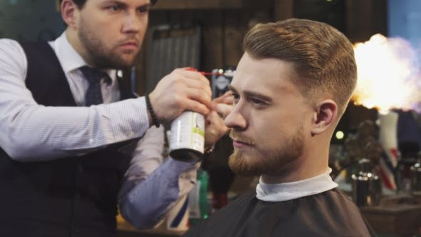 Thumbnail for Handsome Bearded Man Getting Fire Hair Treatment at the Barbershop