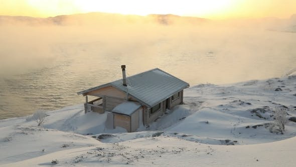 Thumbnail for Wooden Cottage on the Winter Seashore at Dawn