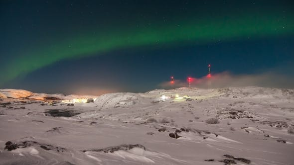 Cover Image for Northern Lights in the Snow-covered Mountains. Norway