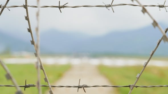 Thumbnail for Airport View Through the Barbed Wire Fence in Mountains - Georgia