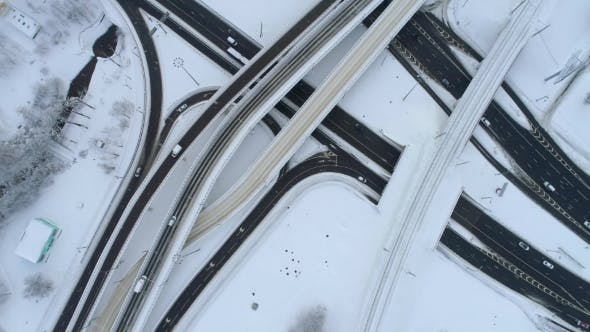 Thumbnail for Aerial View of a Freeway Intersection Snow-covered in Winter.
