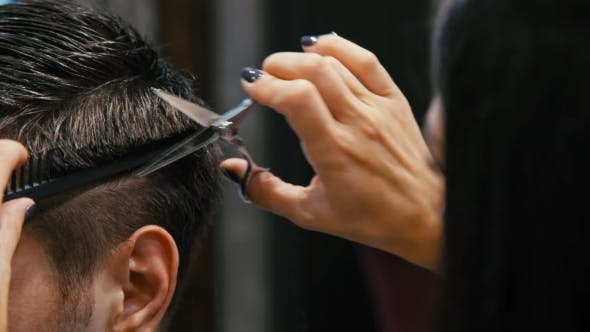 Cover Image for Man Is Cut in a Hairdresser's
