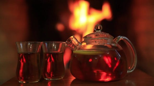 Thumbnail for Hot Tea with Two Glasses Near Fireplace Magic Cozy Evening Concept