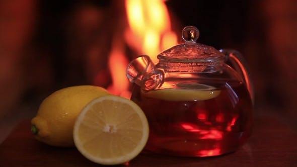 Thumbnail for Hot Tea with Lemon Near Fireplace Magic Cozy Evening Concept.