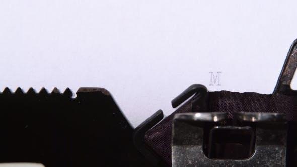 Thumbnail for Businessman Prints Word Marketing on Retro Typewriter.