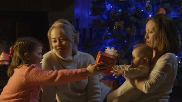 Thumbnail for Cheerful Women with Kids Giving Presents