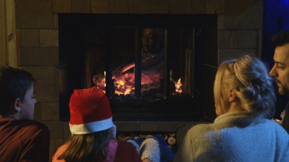 Thumbnail for Family Spending Time at Fireplace in Christmas