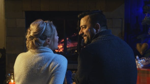 Thumbnail for Married Couple Sitting in Front of a Burning Fire