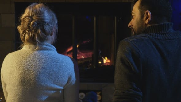 Cover Image for Married Couple Sitting in Front of a Burning Fire