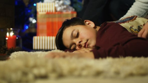Thumbnail for Kid Sleeping Near Fireplace in Christmas Night