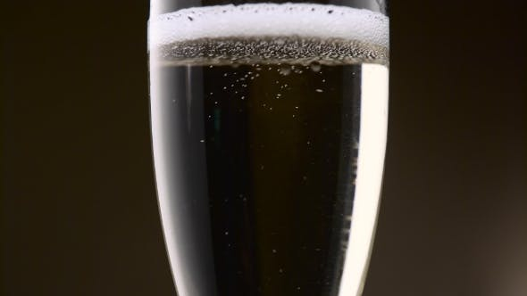Thumbnail for Bubbles of Champagne Are Intensely Circling in a Glass.