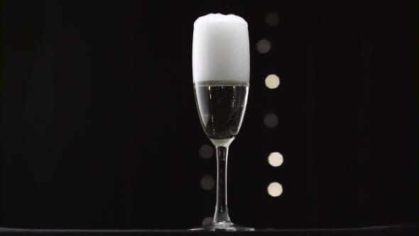 Thumbnail for Half Empty Glass of Champagne Filled To the Brim