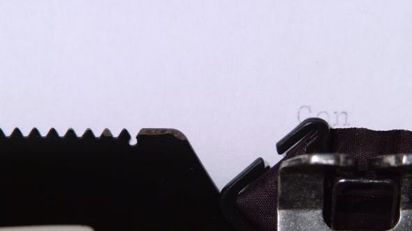 Thumbnail for Head Writes the Word Congratulations on a Sheet of a Typewriter