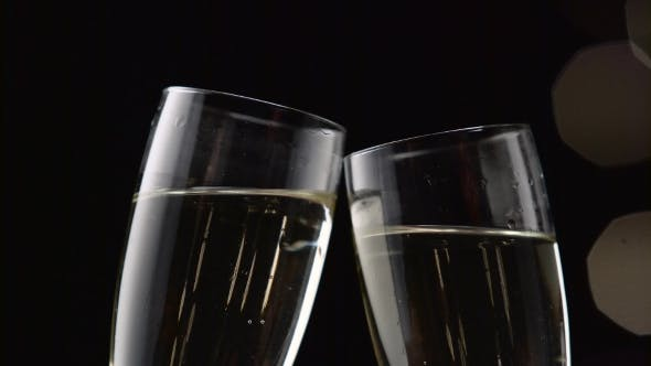 Thumbnail for Two Glasses with Sparkling Champagne Toasting Over Holiday