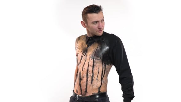 Thumbnail for Sexy Man in Black Bodyart in the Form of a Leaked Shirt Takes Out From Behind a Gift