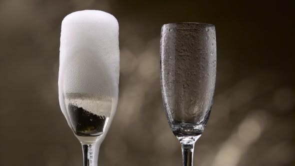Thumbnail for Champagne Pouring in Two Glasses of Steamy Green Bottle. Bokeh Background