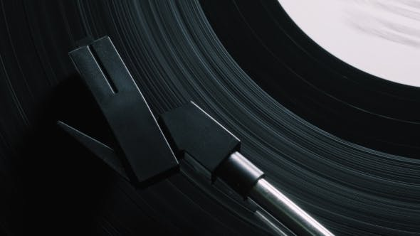 Thumbnail for Vinyl Record on Turntable, Viewed From Above. Pick-up Lifts Off