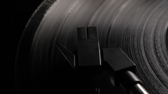 Thumbnail for CINEMAGRAPH - Seamless Loop. Vinyl Record Is Being Played on a Modern Turntable on Bed