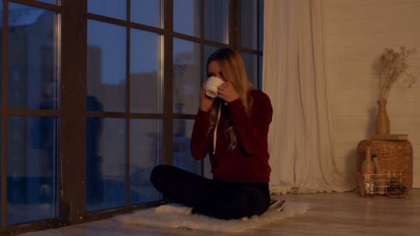 Thumbnail for Elegant Calm Girl Enjoying Cup of Tea By Window