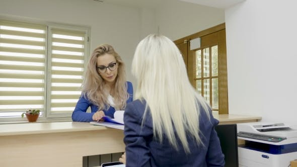 Thumbnail for Blonde Secretary and Her Boss Meeting at the Greeting Desk