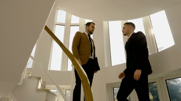 Thumbnail for Successful Business Partners Executives Shaking Hands on the Stairs of Office Building