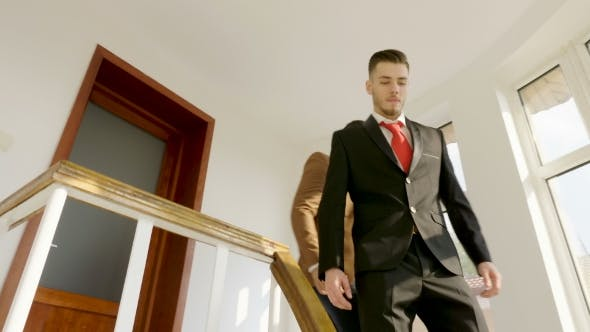 Thumbnail for Two Businessmen Opening the Door of an Office and Getting Out on the Stairs