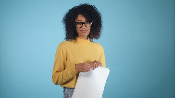 Thumbnail for Breaking Contract. Furious Young African American Woman with Afro Hairstyle Tearing Up Paper