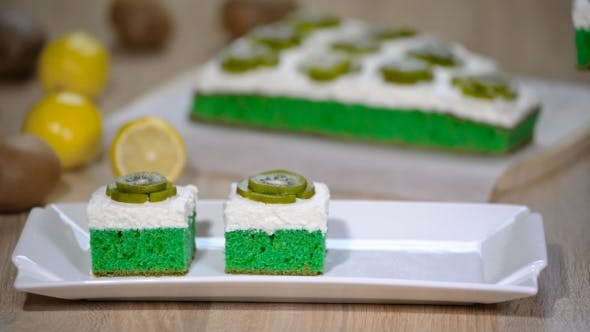 Thumbnail for Put in White Plate Green Soft Cake with Whipping Cream and Topping with Kiwi