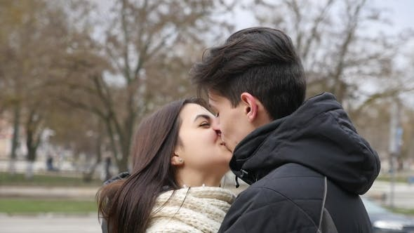 Thumbnail for Lucky Man Kisses Passionately His Cutie Gir in a City Street in Winter