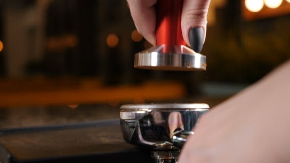 Thumbnail for Coffee House Coffee Making Barista at Coffee shop Tamping Fresh Ground coffee Barista Is Preparing