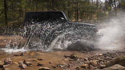 Jeep Splashing Water Off Road