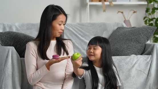 Asian Family at Home Young Korean Mother Holds Homemade Cookies Baked Goods Sweets in Her Hand