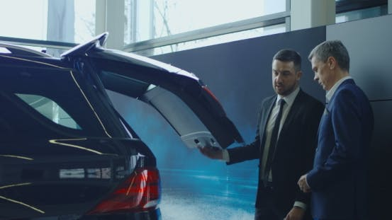 Agent Showing Trunk To Man