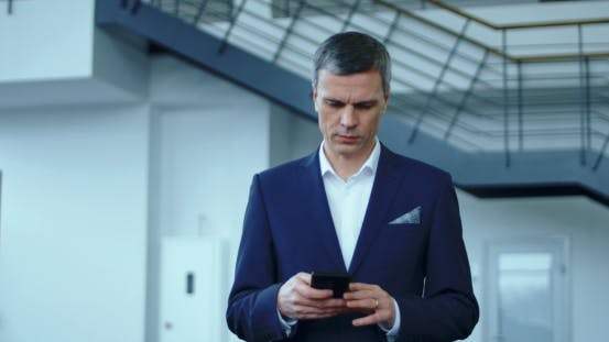 Thumbnail for Businessman in Suit Using Phone