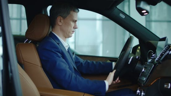 Thumbnail for The Businessman Sets Up Sitting in the New Car