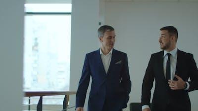 Businessmen Walking in Office