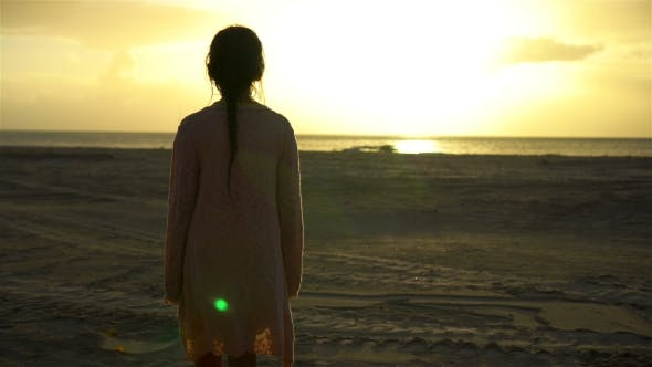 Thumbnail for Adorable Happy Little Girl Walking on White Beach at Sunset