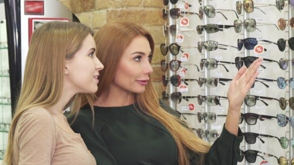 Thumbnail for Two Beautiful Young Women Choosing Eyewear in Optician Store